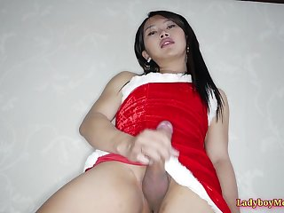 Thai shemale Tou wears Christmas outfit gives lucky guy a blowjob and long frottage pleasure.