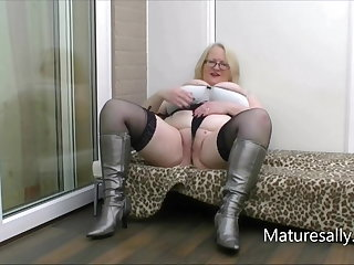 Sally strips nearly to her silver boots and stockings