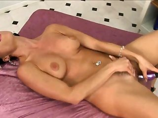 Beautiful toddler with precise curves dildoing herself