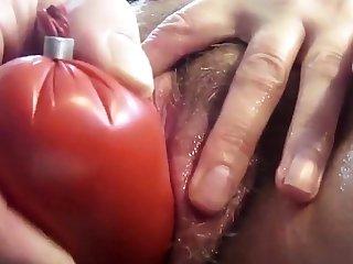 Cumslut fucks an aubergine