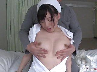 Amateur video of a sexy Japanese nurse riding a large manhood